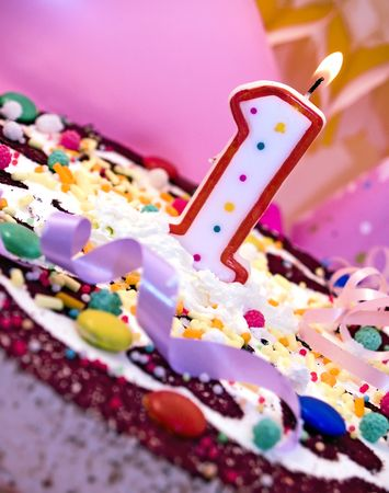 Birthday cake with candle, close up Stock Photo