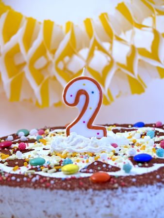 customs and celebrations: Birthday cake with number two candle