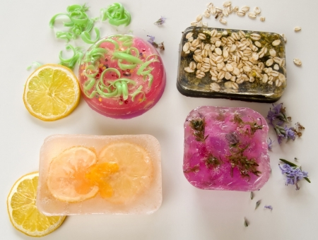 Colourful homemade soaps bars laying at white background Stock Photo