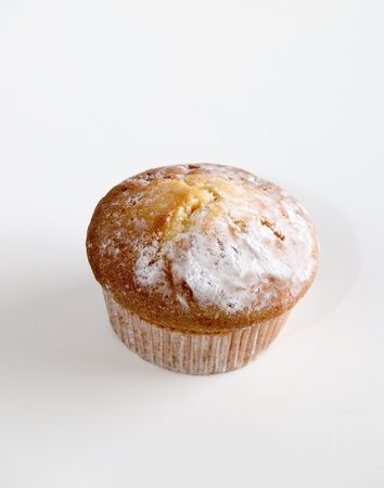 Fruit muffin at white background photo