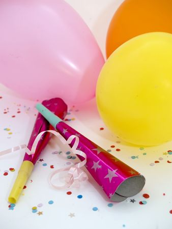 Balloons, noise makers and confetti photo