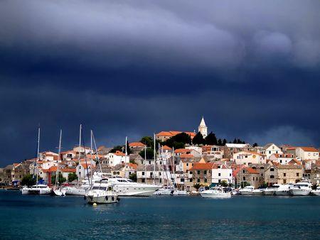 horozontal: Small mediterrane citty  before storm Stock Photo