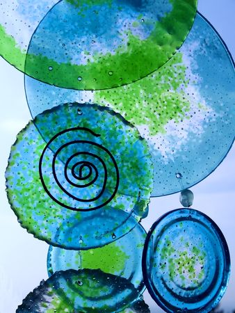 Blue and green glass plates hanging like wind chimes
