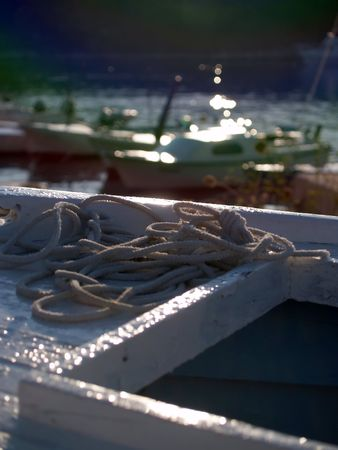 The rope at bow, boats at background Stock Photo - 468452