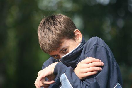 Afraid boy covering him self photo