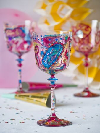 Colorful decorated glasses, birthday decorations at background Stock Photo