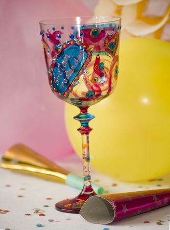 Colorful decorated glass, party decorations at background Stock Photo