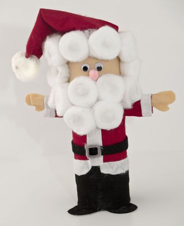 close up of santa toy made of felt, white background