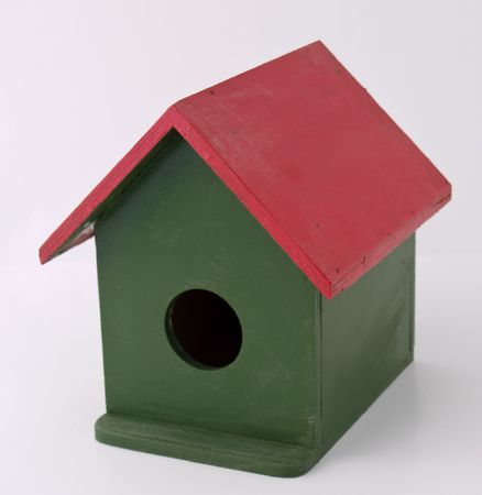 wooden bird house at white background