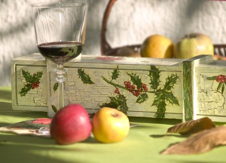 table scene with vintage vine box apple and glass of red vine Stock Photo