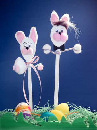 easter rabbits made of wooden cooking spoons at blue background Stock Photo