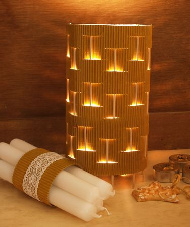 close up of cardboard lamp with candles