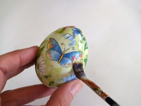close up od decorating egg with decoupage tehnic  Stock Photo