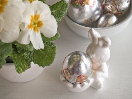 decorated silver eggs at easter table Stock Photo