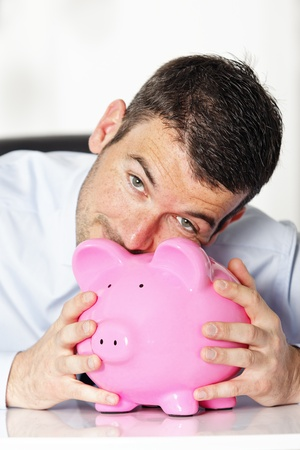 kiss piggy bank photo