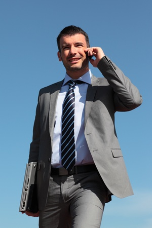 businessman on the phone in blue sky Stock Photo - 9305768