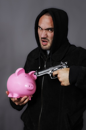bad boy with pink piggy bang and gun photo