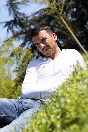late thirties: young man on the grass in a park Stock Photo
