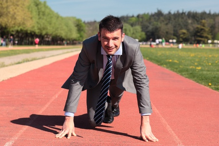 young businessman on running track in summer Stock Photo - 9769968