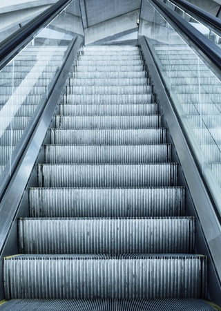 escalator in France airport with terminal panel photo