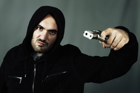 man with a gun and special photographic processing photo