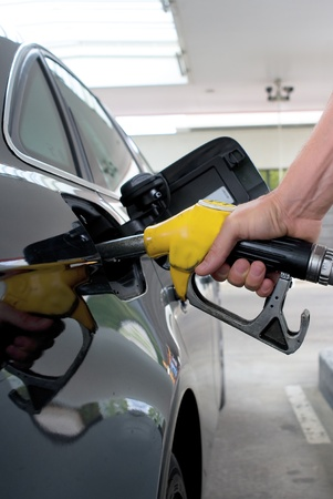 gasoil: Close-up pumping gasoline on the black car