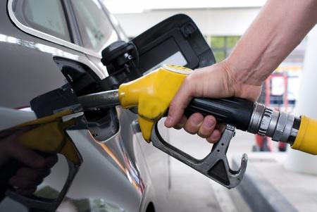 Close-up pumping gasoline on a black car