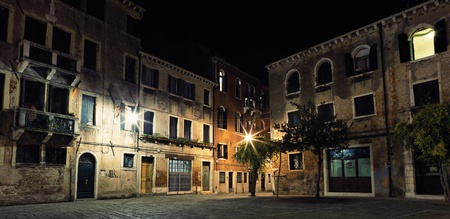 romantically: Little place with paving stone in Venice by night