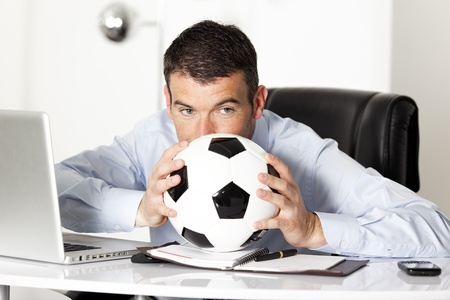 businessman in office with computer and ball