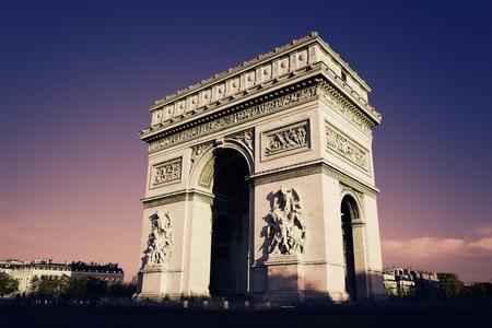 Paris, Arc de Triomphe in the evening