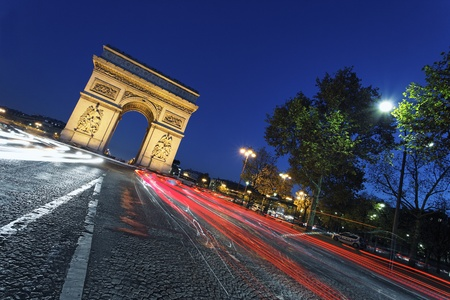 the Arc de Triomphe by night, Paris France  photo