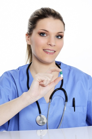 woman doctor with pill in the hand photo