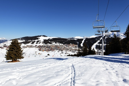 chair lift: alpine village and chair lift in winter Stock Photo