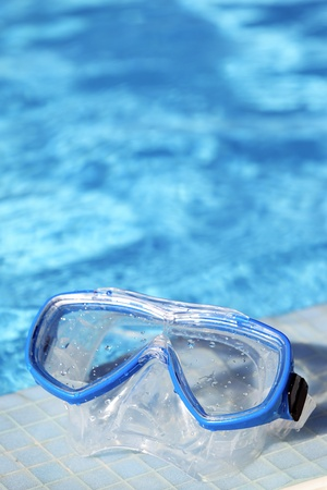 snorkel goggles and water of swimming pool  photo