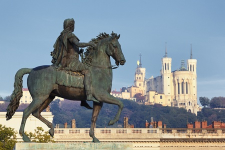 Statue of Louis and Basilique Fourviere on a background Stock Photo
