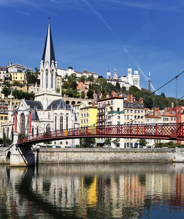 Lyon city with red footbridge on Saone river and church