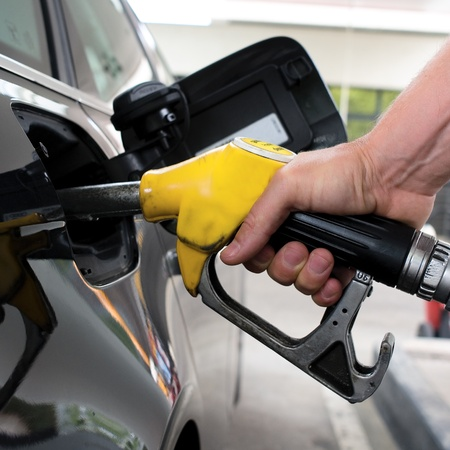 gasoil: pumping gasoline on a black car in station Stock Photo