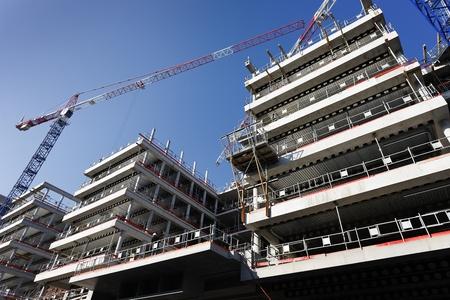 big construction site with crane and blue sky