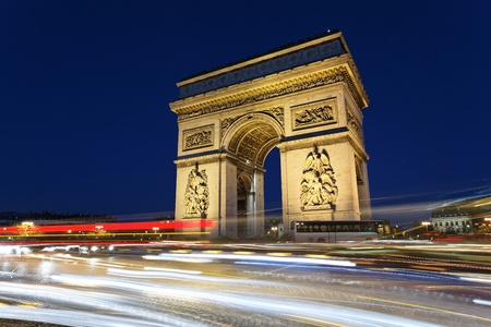 Arc de Triomphe by night with car lights photo