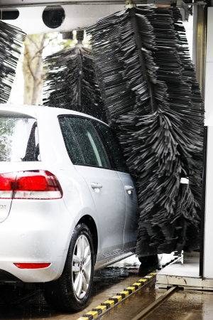 pollution free: back of grey car during washing process Editorial