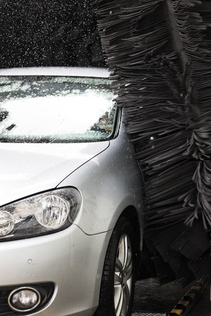 grey car during washing process photo