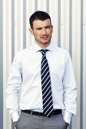 Portrait of handsome man posing with hands in pockets Stock Photo - 13568810
