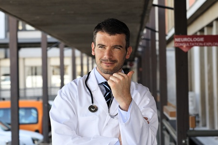 handsome doctor with stethoscope in hospital hall Stock Photo - 13568811