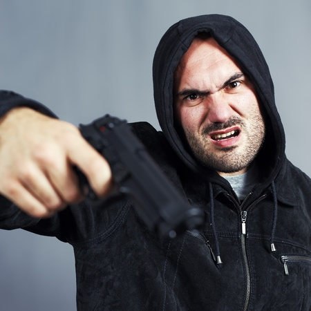 very bad boy with a gun in the hand photo