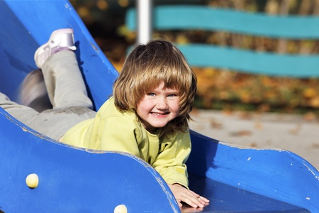 portrait of child playing on colorful playground  photo