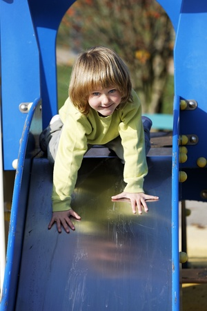 Small child playing on colorful toboggan photo