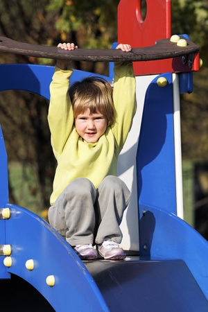 Small child playing on colorful playground  photo