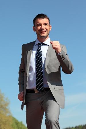 runing: businessman runing outdoor in summer Stock Photo
