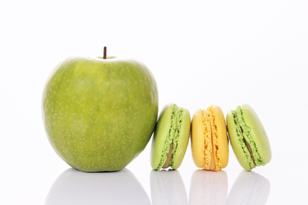 green apple with green and yellow macaroons photo