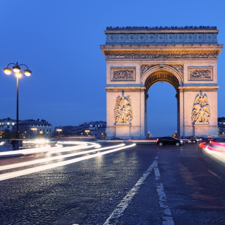 view of  famous Arc de Triomphe by night, Paris photo